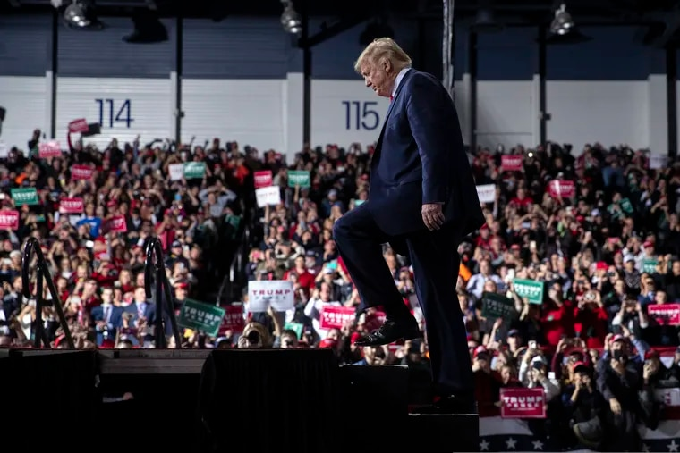 President Donald J. Trump arrives at a campaign rally in Battle Creek, Mich. on Wednesday, the same day the House voted to approve two articles of impeachment against him.