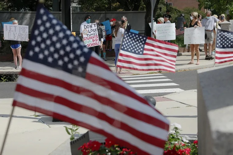 A group comprising mostly parents and students call for the Central Bucks School District to offer in-person classes during a protest in downtown Doylestown last August.