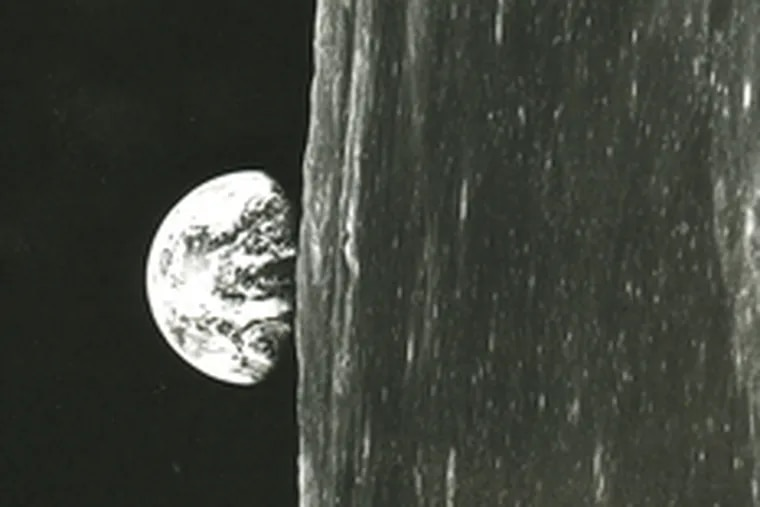 Earth rising , as seen from outer space. This is an image that was first seen by human eyes during the Christmas season 40 years ago, when U.S. astronauts orbited the moon.