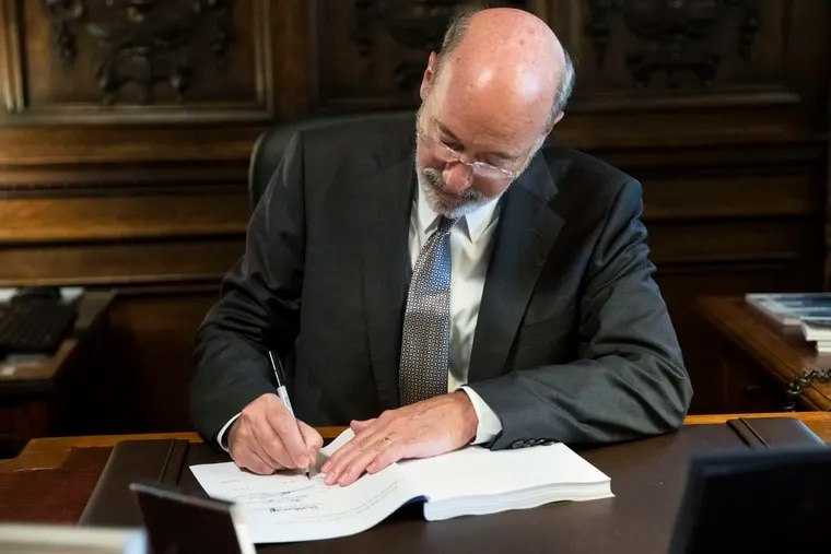 Pennsylvania Gov. Tom Wolf signs the main appropriations bill in a $34 billion budget package that passed the Legislature on June 28, 2019 at the state Capitol in Harrisburg. The budget did not include a statewide minimum wage increase.