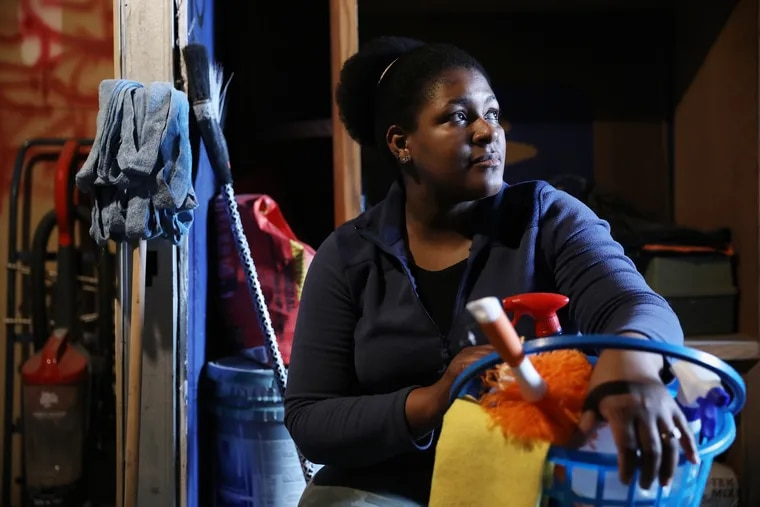 Betania Shephard, a domestic worker who cleans Airbnbs, sits for a portrait at her home in Northeast Philadelphia on Thursday, March 12, 2020. Shephard has seen her business fall drastically, likely due to the coronavirus.