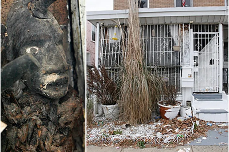 Investigators removed two emaciated dogs and bags of animal bones from this home in Feltonville, where animal sacrifices were believed to have been held. At left, a statue also found at the home. (Alejandro A. Alvarez / Staff)