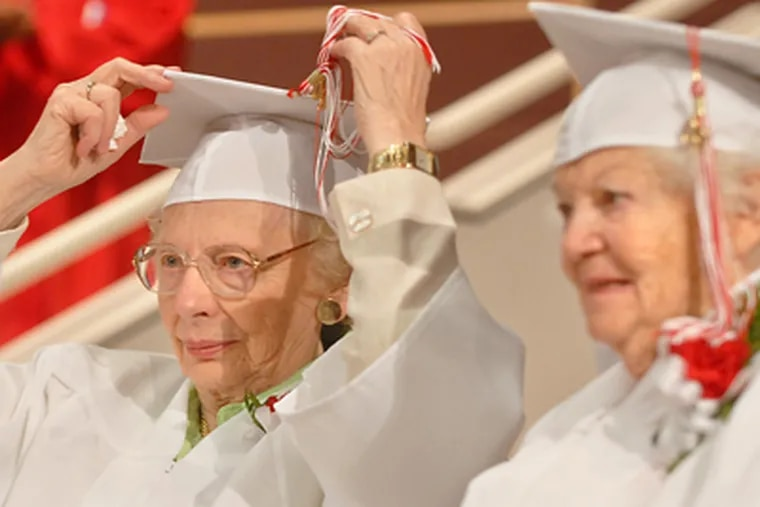 Viewing the ceremony are Dorothy Watson McAuley (left), 85, and Marion Goldsmith Klarman, 91. Both had to leave school early to work. (Tom Gralish / Staff Photographer)