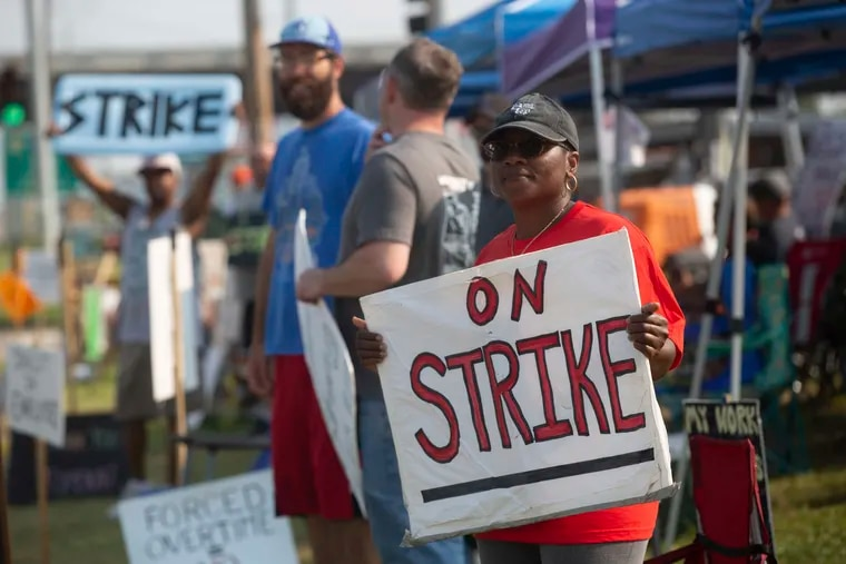 Kym Lewis, a Frito-Lay employee, stands on the strike line Thursday, July 22, 2021 outside of the Topeka plant. Workers said the main points of contention are small pay increases and employees being forced to work hours of overtime.