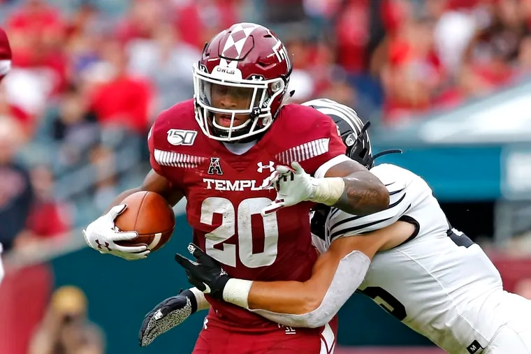 Temple running back Re'Mahn Davis tries to escape the grasp of Memphis linebacker Austin Hall during the fourth quarter of an American Athletic Conference football game Saturday, Oct. 12, 2019, at Lincoln Financial Field. The Owls went on to win, 30-28. LOU RABITO / Staff