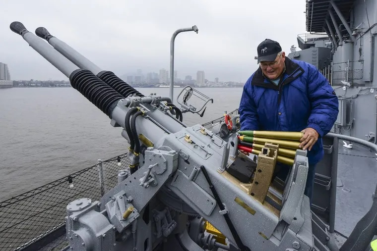 Gary Mahan, 69, founder/president/director of The Mahan Collection and Museum of Basking Ridge, NJ, places 40mm shells in a rack on the Bofors Quad 40mm anti-aircraft gun he refinished and reinstalled on the port side of the Battleship New Jersey November 13, 2017.