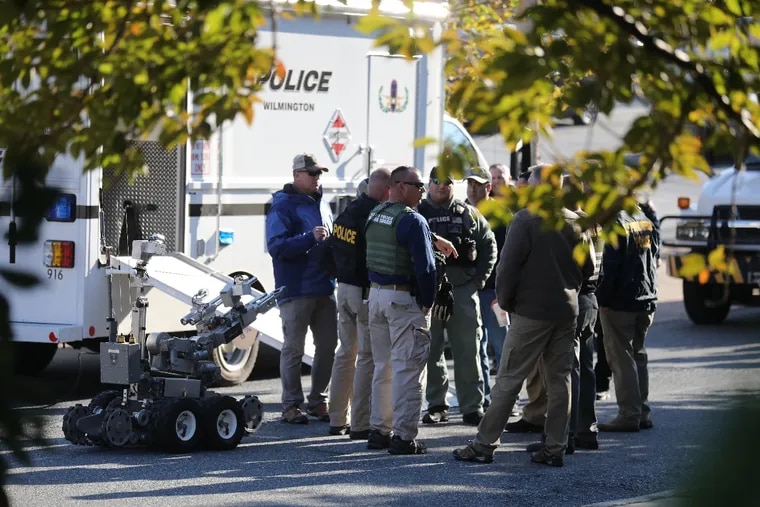 Local and federal authorities remove a suspicious package found at a US postal facility on Lancaster Avenue in Wilmington, Del. Addressed to former Vice President Joe Biden Thursday October 25, 2018.