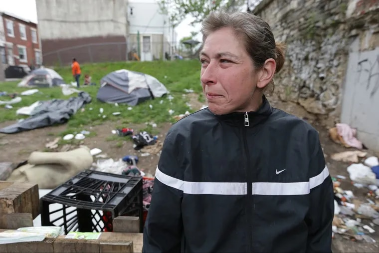 Joanne Smith, 41, who said she has been living under the bridge at Kensington and Lehigh for a year, talks of finding housing in Philadelphia, PA on May 22, 2018. Smith and others living under the bride will need to relocate by the end of this month.