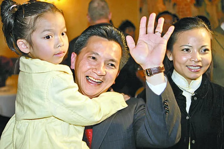 """Republican Anh """"Joseph"""" Cao, daughter Betsy, and wife, Kate Hieu Hoang, after he defeated Rep. William Jefferson (D., La.). Anh will be the first Vietnamese American in Congress."""