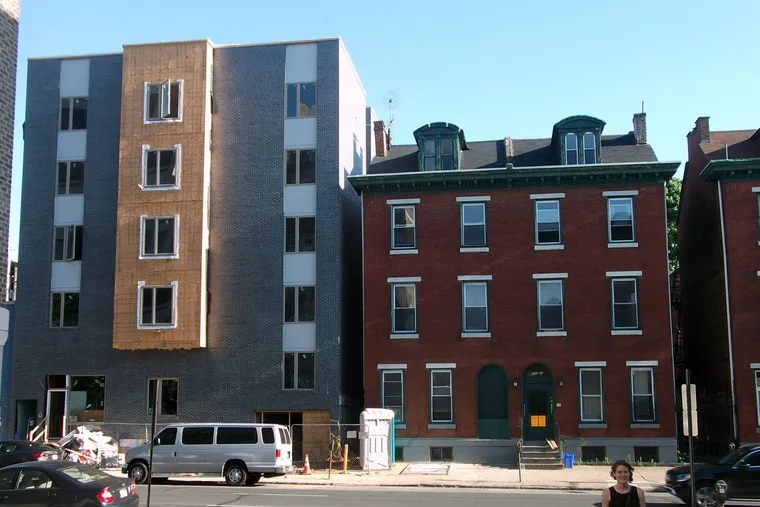 Two 19th-century townhouses near 40th and Chestnut were replaced by developers benefiting from the cities' property-tax abatement. What is lost: the 1850s character of the neighborhood.