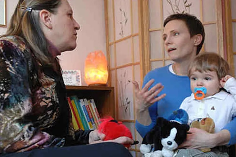 Homeopath Begabati Lennihan (left) consults with Kate Sonin of Arlington, Mass., and her son Udo, 2. Like other homeopaths, Lennihan considers not just patients' symptoms but also temperaments, favorite foods, even dreams. (Josh Reynolds / AP)