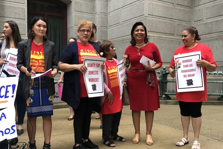 Councilwoman Maria D. Quinones-Sanchez, second from right, stands with Philadelphia domestic workers and members of the Pennsylvania Domestic Workers Alliance outside City Hall on Thursday morning. The councilwoman is the prime sponsor of legislation aimed at increasing labor protections for domestic workers like nannies and house cleaners.
