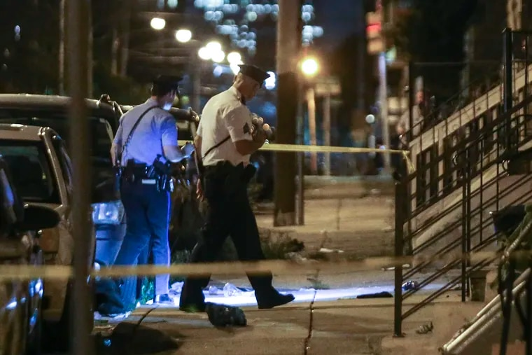 Police investigate a scene in the 2100 block N.18th street where a 14-year-old boy was shot and is in critical condition at Temple University Hospital, Tuesday, August 24, 2021