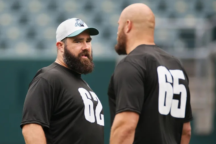 Eagles center Jason Kelce (62) talks with tackle Lane Johnson (65) during practice at Lincoln Financial Field in South Philadelphia on Friday, June 4, 2021.