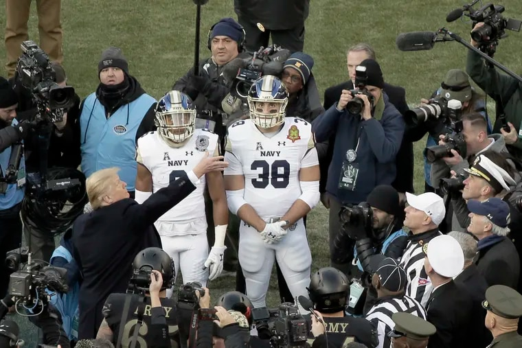 President Trump tosses the coin prior to the 119th Army vs. Navy football game at Lincoln Financial Field in Philadelphia.