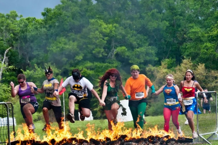 The 2012 Warrior Dash in Live Oak included a fire pit. The Superheroes joined hands and jumped. (Photo Credit: Dave Valdez)