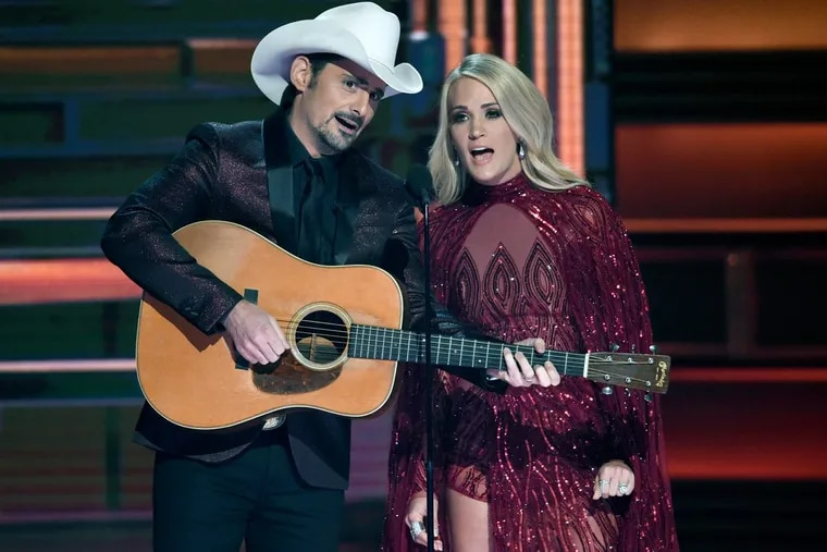 Hosts Brad Paisley and Carrie Underwood appear during the opening of the 51st annual CMA Awards at the Bridgestone Arena on Wednesday in Nashville, Tenn.
