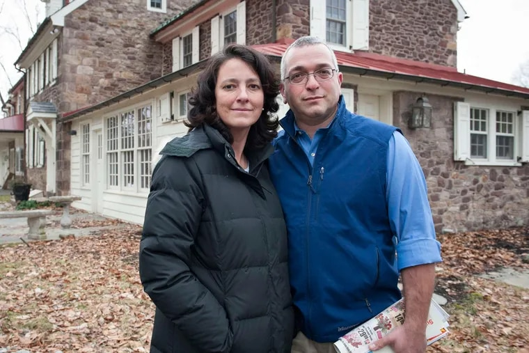 Amy Reed and Hooman Noorchashm pictured outside of their home. A machine used on her fibroids spread what was yet an undiagnosed cancer.