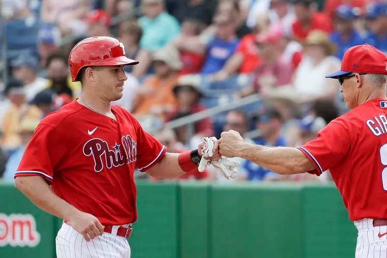 J.T.  Realmuto (left) and Joe Girardi believe the Phillies will have a lot of power in their lineup this season.