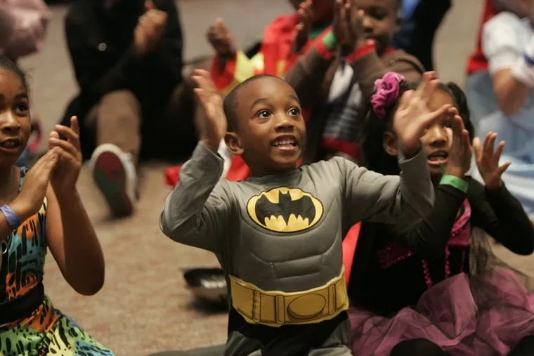 In this file photo, a 6-year-old Batman celebrates Halloween.