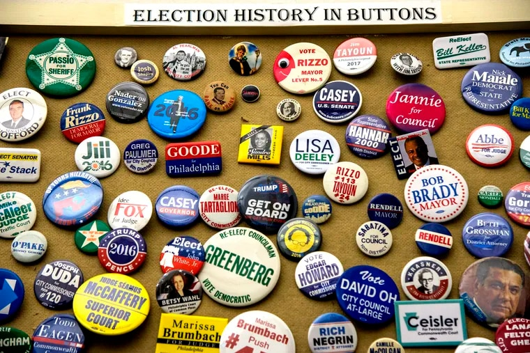 Campaign buttons from decades of Philadelphia elections are collected on a bulletin board at the Board of Elections in City Hall March 12, 2019, as the deadline looms for candidates to file nomination petitions to get on the May 21 primary ballot. The staff locks the office door at 5 p.m. sharp.