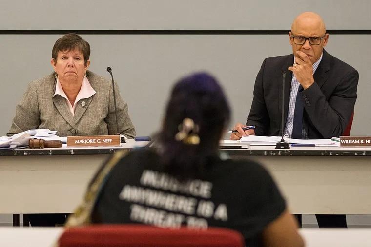 Majorie Neff and William Hite listen to public testimony.