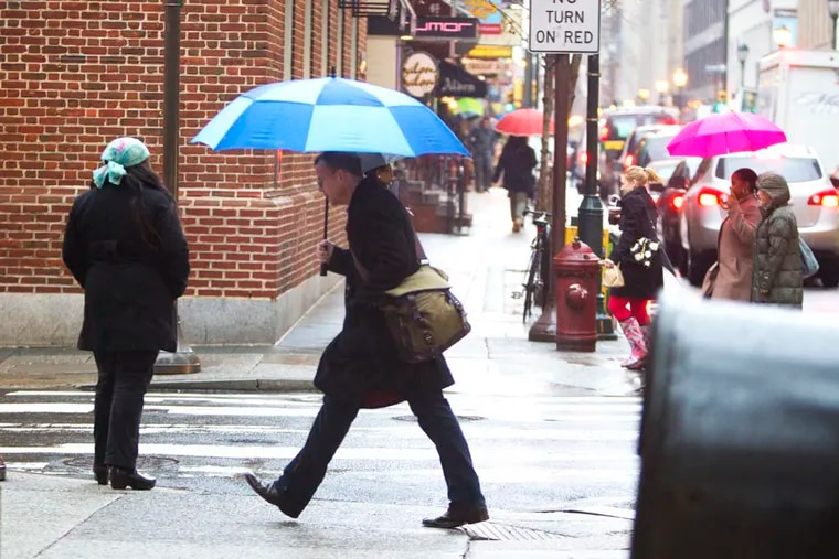 You'll need an umbrella, not snow boots, for the first day of winter. just as they did on this January day in 2014.