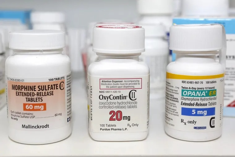 Containers of the opioid-containing drugs morphine sulfate, OxyContin and Opana, in a 2013 photo.