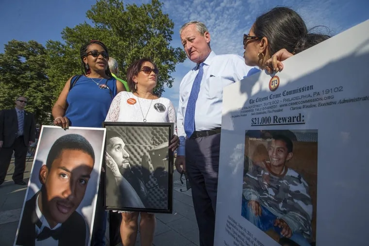 Mayor Kenney talks to  (from left) Trina Singleton, Lisa Espinosa, and Kathy Lees, all of whom lost sons to gun violence.