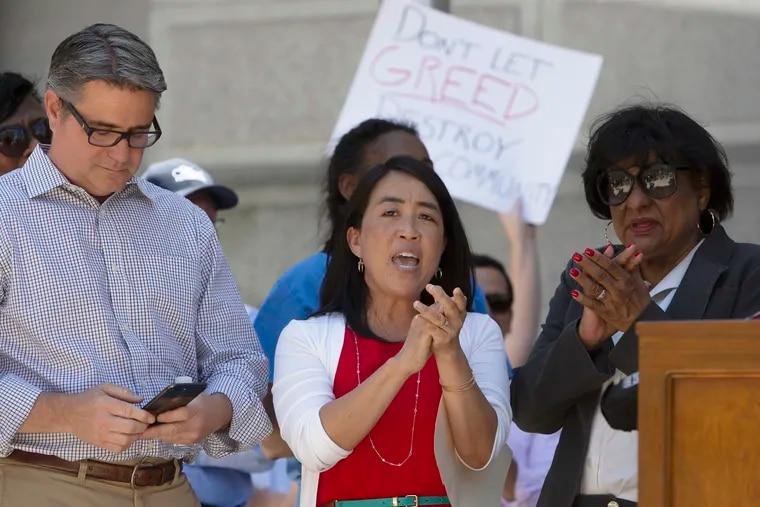 "Philadelphia City Councilwoman Helen Gym (center) has said her indicted colleague Bobby Henon (left) is ""a good majority leader."""