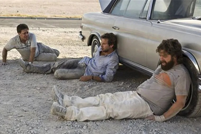 """Zach Galifianakis, right, Bradley Cooper, center, and Ed Helms are shown in a scene from """"The Hangover."""" (AP Photo/Warner Bros., Frank Masi)"""