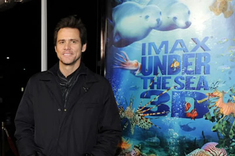 """Jim Carrey, who narrates the IMAX film """"Under the Sea 3D,"""" arrives at a special screening of the film at the California Science Center IMAX theater in Los Angeles, Thursday, Feb. 5, 2009. (AP Photo/Chris Pizzello)"""