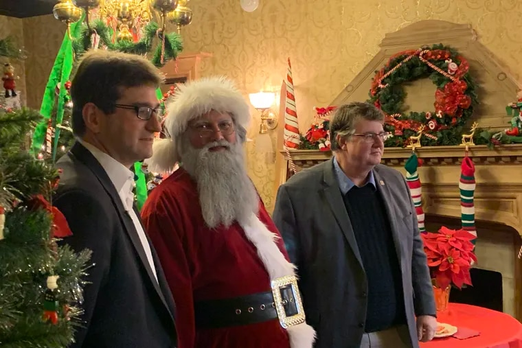 New Castle County Executive Matt Meyer (left) with Santa Claus and county councilman John Cartier at Rockwood Park and Museum earlier this month.