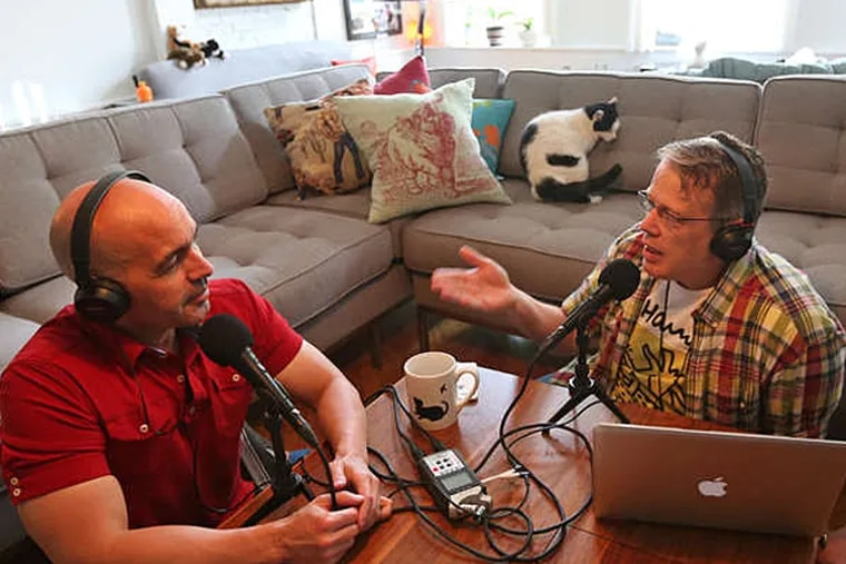 Podcasters Lorenzo Marquez (left) and Tom Fitzgerald bicker like the married pair they are. (DAVID SWANSON / Staff)