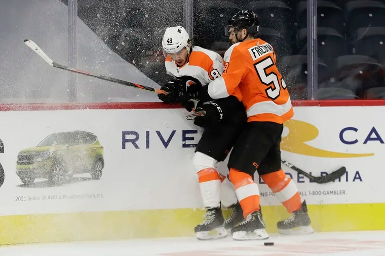 Flyers defenseman Mark Friedman (right) holds center Morgan Frost during an intrasquad game on Sunday, January 10, 2021 in Philadelphia.