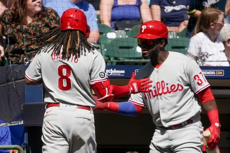 Freddy Galvis is greeted by Odubel Herrera after hitting a home run for the Phillies during the second inning in Milwaukee.