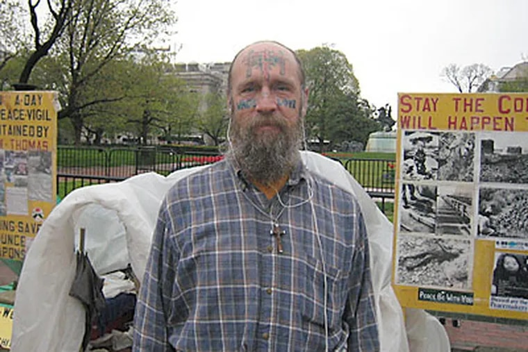 Jay McGinley spends 24 hours a day in front of the White House as a full time protester. He protests against nuclear weapons and conventional energy. (Konstanze Walther / Staff Photographer)