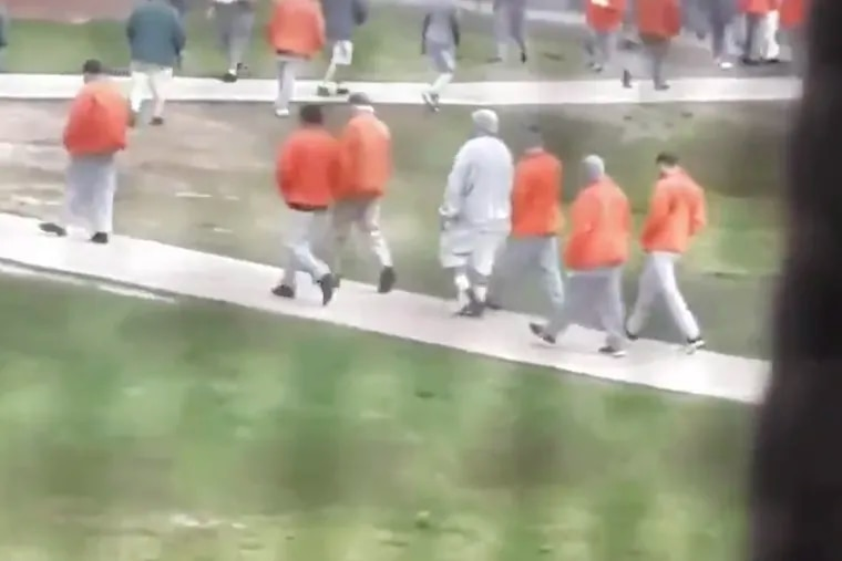 A still from video footage recorded by an inmate with a smuggled cellphone at the federal prison in Fort Dix, N.J. , shows prisoners in the yard, where recommended social distancing guidelines don't appear to be followed. The video was posted to Twitter last month.