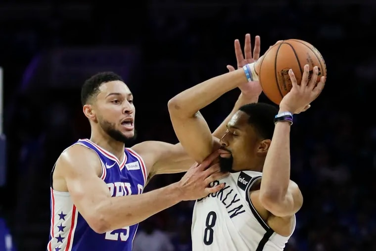 Sixers guard Ben Simmons defends Brooklyn Nets guard Spencer Dinwiddie during the second-quarter in game one of the Eastern Conference playoffs on Saturday, April 13, 2019 in Philadelphia.