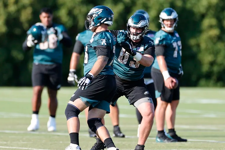 Eagles offensive tackle Jack Driscoll (right) works on blocking drills with offensive tackle Casey Tucker during training camp at the NovaCare Complex on Saturday, July 31, 2021.