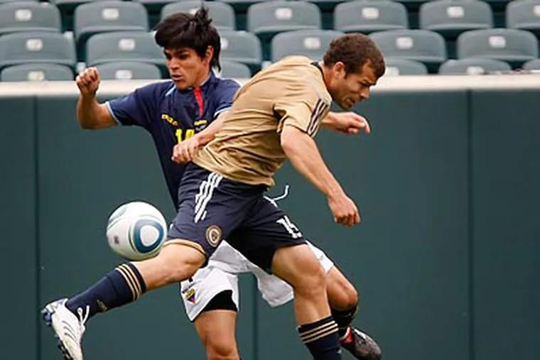 Ecuador's Giancarlos Ramos (left) and the Union's Alejandro Moreno contest a loose ball. (Michael S. Wirtz/Staff Photographer)