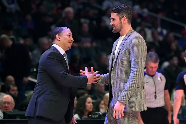 Clippers assistant coach Ty Lue (left) greets Cavaliers forward Kevin Love at a game last season. Would Lue be a good fit to coach the Sixers?
