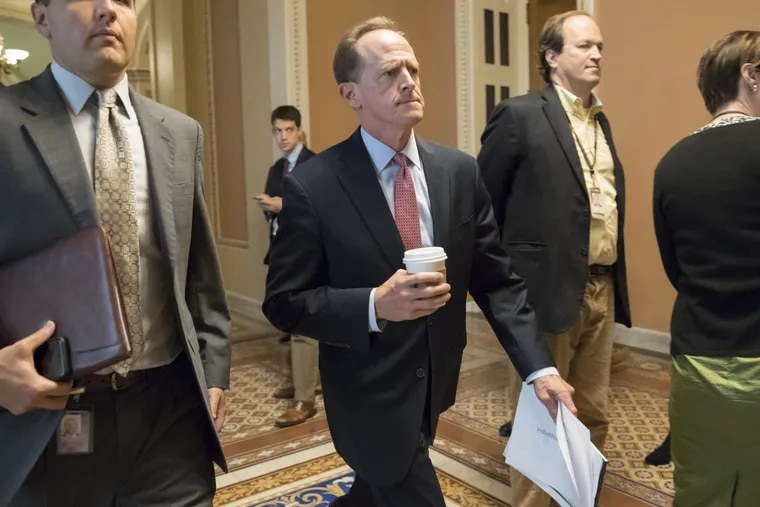 Sen. Pat Toomey, R-Pa., a member of the Senate Budget Committee, strides to a meeting with Senate Majority Leader Mitch McConnell, Treasury Secretary Steven Mnuchin, and Trump economic adviser Gary Cohn earlier this year. (AP Photo/J. Scott Applewhite)