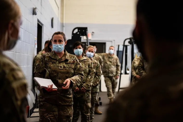 Task Force McGuire-Dix Airmen are briefed on the arrival of Afghan evacuees.