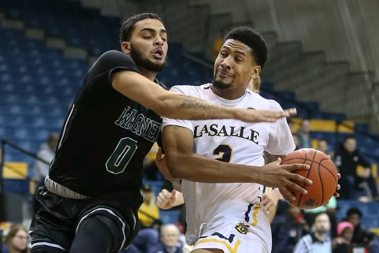 La Salle's Scott Spencer drives at Wagner's Nigel Jackson during the first half.