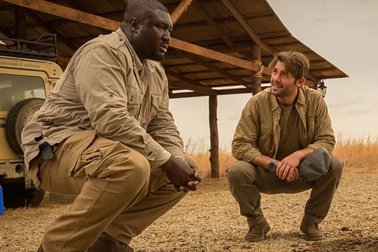 """Animals are attacking people, and Nonso Anozie (left) and James Wolk are racing to find out why in the new series """"Zoo."""" (HILARY BRONWYN GAYLE / CBS)"""