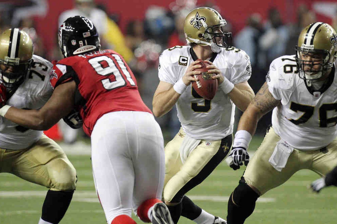 Saints down Falcons, clinch berth