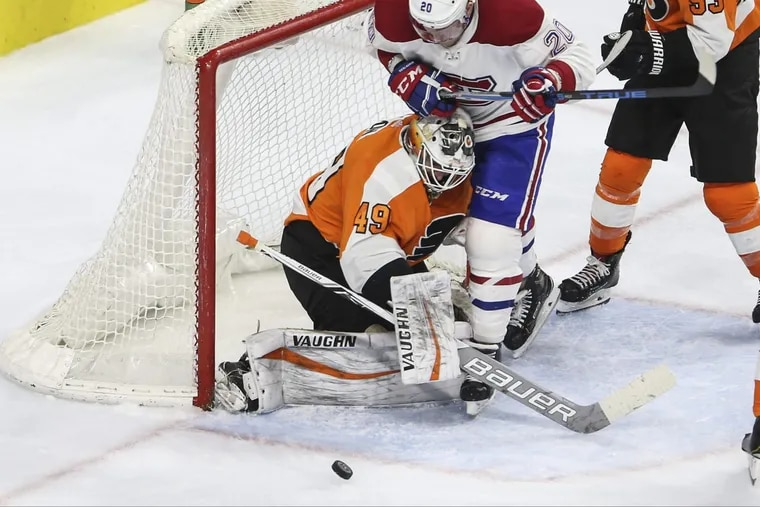 Flyers rookie goalie Alex Lyon, shown making a stop while Montreal's Nicolas Deslauriers battles in front last month, will get the start Saturday night in Carolina.
