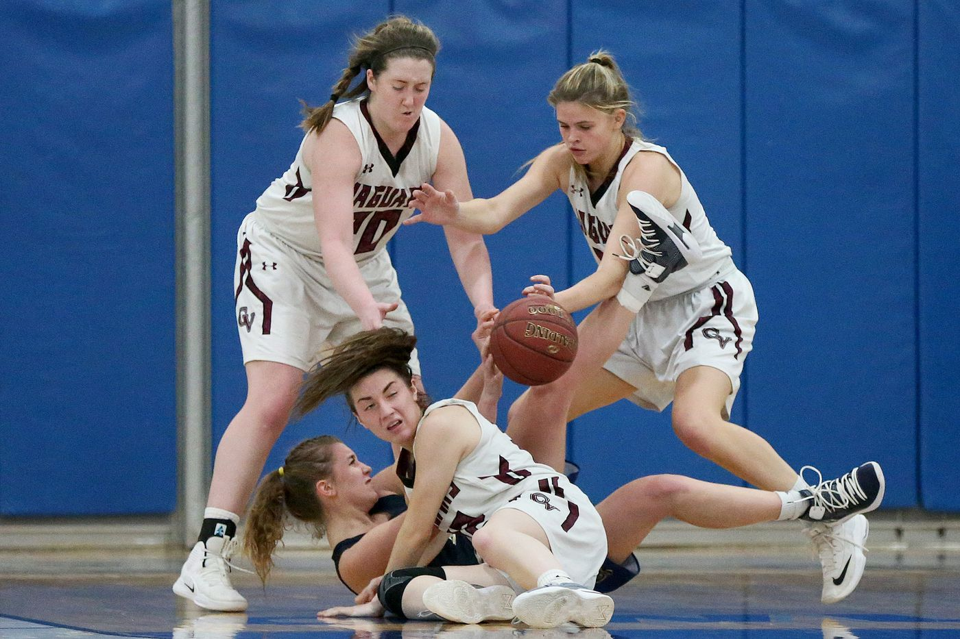 Garnet Valley's Emily McAteer (left), Madi McKee (center, on floor) and Jillian Nagy defend as Spring-Ford's Olivia Olsen tries to throw a pass.