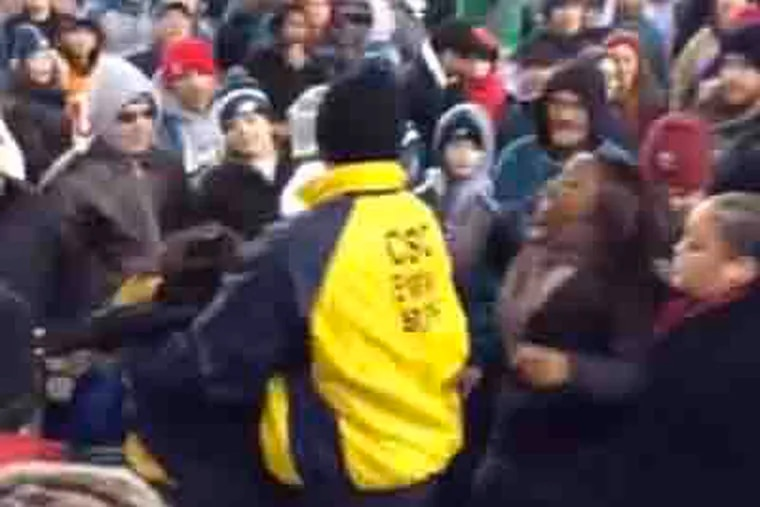 Women fight at the Eagles/Bengals game. Screenshot via YouTube